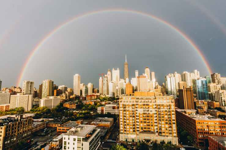 photo of rainbow over skyline